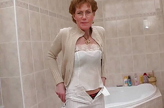 Mature lady shaving in the bathroom