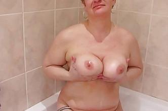 Chubby mommy sucking cock in bathroom
